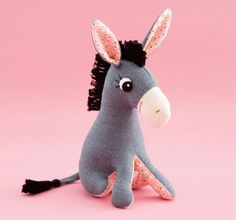 Learn how to make a cute fabric donkey with this tutorial on the Etsy Blog. #DIY