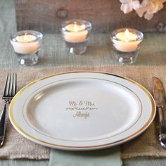 Premium personalized plastic ivory dinner plates with gold trim will have guests thinking you broke out the fine china for your wedding reception.