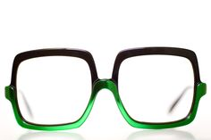 green and black, if these were sunglasses I would so buy...