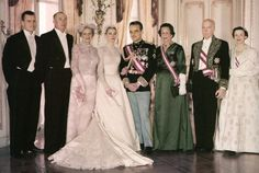 Princess Grace and Prince Rainier posing with their families after their wedding. April 19, 1956.