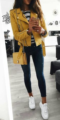 #winter #outfits yellow leather zip-up jacket, white and black striped shirt, and black leggings