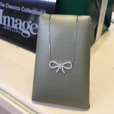 We just added this adorable diamond bow necklace to our Images Classics Collection.