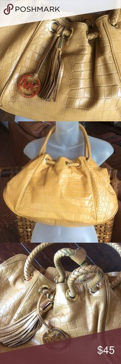 MK Handbag Mustard camel in color. Good used condition. Clean inside. Has a few spots in the weave of the strap, but they are mostly hidden. Michael Kors Bags Shoulder Bags