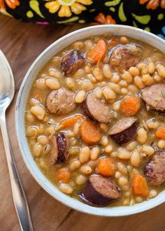 Instant Pot Sausage and White Beans is a hearty and delicious soup made with smoked sausage and white beans. Very easy to make, and much faster in your electric pressure cooker. Make this pressure cooker bean soup from dry beans in about an hour!