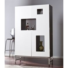 Artfully display and store all of your wine and barware essentials with the Southern Enterprises Shadow Box Wine/Bar Cabinet. Boasting white doors, black cabinet space, and a steel frame, this cabinet gives a sensational allusion of depth and style. Wine Bar Cabinet, Wine Cabinets, Black Cabinets, Modern Cabinets, Bar A Vin, White Bar, Black White, Bar Furniture, Furniture Stores