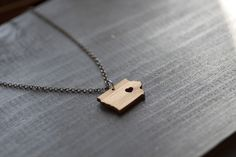 I Heart Iowa Necklace. I really want one of these when I move out of state. A little symbol to show where I'm from and where my family is. Iowa is my home.