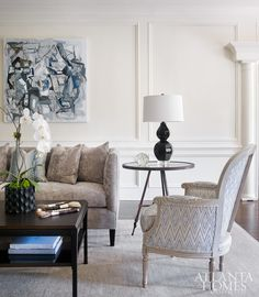 The formal living room feels fresh and contemporary with an Oushak rug from Moattar and a painting by Brian Coleman through Anne Irwin Gallery.