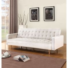 2-tone modern sofa futon/sleeper in soft hand picked linen fabric and features a tufted button design for added sophistication, 2 bolster side pillows and detachable wooden legs.