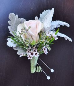 pretty bouteniere with dusty miller, waxflower and blush spray rose