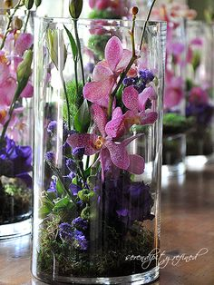 Purple and Green Wedding Centerpiece with Orchids, Statice and Mums from Serendipity Refined