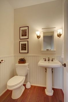 Phinney Ridge Townhouse - beadboard works perfectly in this bathroom with an extremely high ceiling to make the space feel much larger.