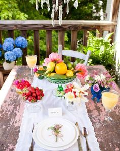 Exotic fruit and flower tablescape for your summer get togethers. Love the vibrant colors by @foxtailcottage