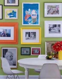 Display of kids art and family photos on one wall