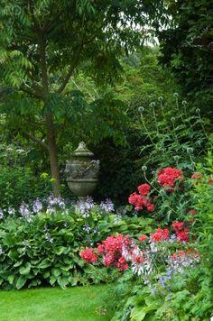 Beautiful stone urn ... love the tucking in. Perennial Garden. Hosta. Phlox.
