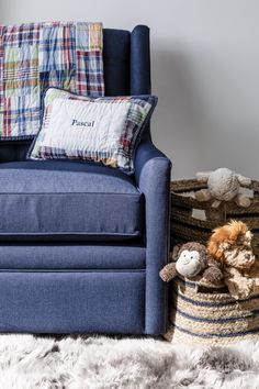 We are suprised at how much we love this denim glider in this nursing nook!  By Farnia Designs