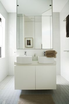 Double sinks are integrated into a partition in the bathroom. This design is from a flat in Sydney designed by Hannah Tribe of Tribe Studio Architects | #Bathroom #InteriorDesign |