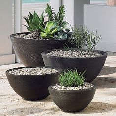 Serve up a big bowlful of modern design--along with plants--with the Crescent Garden Delano Planter. It is large bowl-shaped planter made out of rotation molded polymer resin. The largest size (34 inches) includes a special drainage plug system in the event you want to use the planter as a water garden or fountain instead.