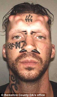 mugshot of a blood-drinking Satan worshipper charged with the kidnap and murder of three members of the Hell's Angels. Caius Veiovis, 31, has undergone extensive implants to create horns on his head and had the number of the devil - 666 - tattooed on his forehead.  He is alleged to have been part of a gang which kidnapped, killed, and buried the men in Massachusetts, USA. He has been charged with the killing of David Glasser, 44, Edward Frampton, 58,