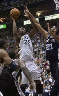 Al Jefferson shoots over Tim Duncan as the Jazz host the Spurs in the first round of the NBA playoffs at EnergySolutions Arena in Salt Lake City, Saturday, May 5, 2012. (Jeremy Harmon  |  The Salt Lake Tribune)