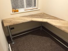 Fitted computer table made from galvanised scaffold poles, tube fittings and some old scaffold boards