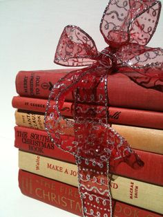 Holiday Book Decor / tie holiday ribbons around Christmas or Holiday themed books and set out to display on a table or even under the tree.