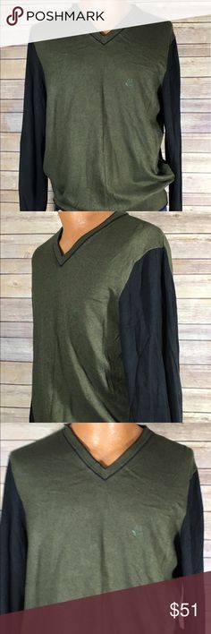 Armani Jeans OliveGreen & Black Wool Sweater,  XXL Armani Jeans Mens Sweater Vneck Left Chest Logo Color: Olive Green Body and Black Sleeves Size: XXL Approximate Top Shoulder to Bottom Hem Measurements: 29 inches Approximate Arm to Arm Measurements: 23 inches Approximate Sleeve Measurements: 29 inches CN# 190/108B Item# 7V6MA26M13Z Made in Tunisia 85% Cotton/15% Wool Excellent Used Condition Armani Jeans Sweaters V-Neck