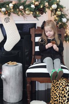 This little angel is waiting for Santa in style! A stylish silver stump, black and white, leopard, and metallic ornaments make for a perfect modern palette by Bethany DeVore of Dwellings by DeVore. || @dwellingsbydev
