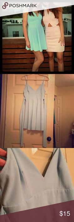 "Pretty Sky Blue Skater Dress Freshly dry cleaned, only worn once! Super flattering skater style pale blue dress from a small boutique label. I got SO many compliments on this dress, it's the perfect Cinderella dress color. Would fit small or medium with an adjustable sash tying in the back. 27"" waist, 23"" from front V to bottom of the skirt. lovely day Dresses Mini"