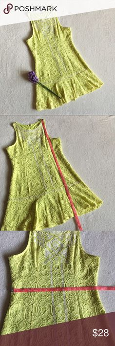 NEW Lime Green Lace Tribal Print Drop Waist Dress New with tags!  Lime green drop waist lace dress.  Tribal print pattern.  Gold zipper in back. Fully lined. No stretchy.  60% Cotton, 40% Nylon.   Please see photos for measurements.   Feel free to make an offer via offer button only.  NO TRADES Boutique Dresses