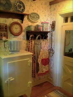 Love the door frame and the canisters. Antique fridge is very well done.