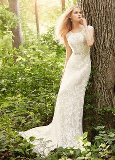 Ivory lace over Champagne Charmeuse A-line bridal gown. Sheer bateau neckline and low open back. Jeweled crystal applique on ribbon at the natural waist.