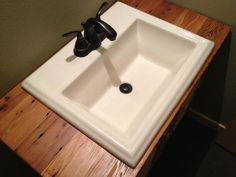 $129 sink on butcher block countertop. I like it.