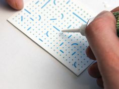 Csaba Mózes - the blind masseur / by Péter Serfőző of Budapest-based Zwoelf/ identity / branding / braille design / business card / using clear glue to make the design 3D braille