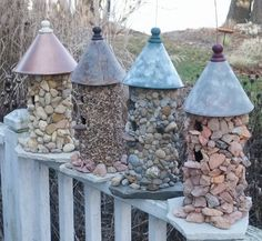 bird houses... DIY would be to cut sections of PVC pipe in the height you want for the bird house, drill or cut holes in the side as the entry, hot glue rocks, or glass stones to the PVC pipe, attach a funnel to the top, could use a piece of tile or slate for the bottom....How cool and great kids project