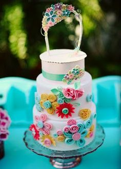 I am in LOVE with this cake. I love how the flowers are made. http://www.kaylaskakes.com/index2.php#/gallery1/1/