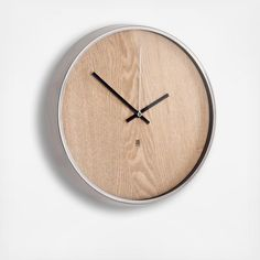 This clock features an ashwood veneer face with a walnut stain and an aluminum rim with indicastors on the glass.