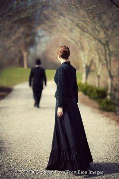 © Susan Fox / Trevillion Images - historical-couple-on-treelined-path