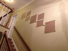 "Hang art along a staircase wall...could work on any wall that you want to do a ""gallery"" of multiple pictures/frames."