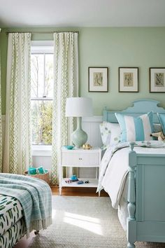 Sarah Richardson mint green bedroom with Tiffany blue cottage style bed, green walls, and white nightstand