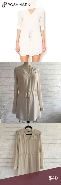 🎆Shirt Dress NWOT Nude Shirt Dress by Naked Zebra   Perfect day dress, roll up sleeves, tie at the waist, size S, 100% Polyester. New no tag   Ⓜ️chest 36 Ⓜ️sleeves 26 Ⓜ️length 33 Ⓜ️waist 32  ✅Bundle and save  ✅🚭 ✅ all reasonable offers will be considered 🚫No Trading 🙅🏻 Poshmark rules only‼️ naked zebra  Dresses Long Sleeve