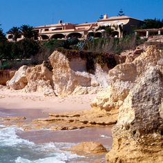 On a cliff above the sea in Southern Portugal's Algarve, the distinguished Vila Joya hotel shines like a precious stone offering exclusivity, luxury and good taste. Portugal, Algarve, To Go, Southern, Mansions, World, House Styles, Water, Places
