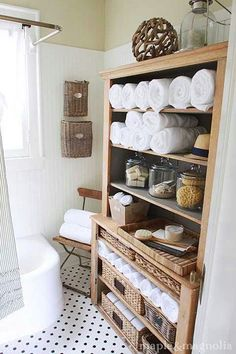 Bathroom storage, the glass canisters and hanging wicker basket on wall