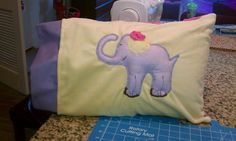 Drew this elephant from scratch and sewed every bit of it. I stuffed the elephant so it would POP out a bit. The flower ruffle pops out too!! This is one side of the Elephant Pillow
