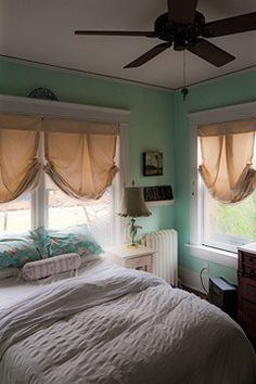 tiny bedroom is delightful because it has windows on two sides