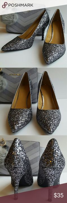 Nine West Sparkle Pumps Super fun, sparkley pumps! Practically new, worn once with small signs of wear on the bottoms of the heels. They are a dark grey color. Heel is 3.5 inches. Perfect for NYE! Nine West Shoes Heels