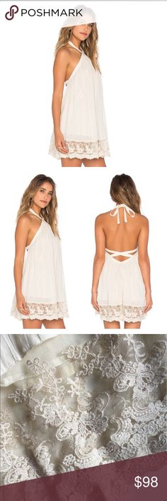 """TULAROSA HOLDEN DRESS TULARSOA IS A LA LABLE, IT REFLECTS A VINTAGE-INSPIRED ROMANTIC LOOK IN THEIR DRESSED. THIS BEAUTIFUL DRESS FEATURES A HALTER STRAP TIE AROND THE NECK. CRISS CROSS BACK CUT OUT   LACE TRIM HEM THAT SHOULD BE ON A WEDDING DRESS. FULLY LINED THOUGH BODY. LINING STOPS ABOVE LACE. THIS DRESS FITS LIKE A 8-10. BUST 36-37. LENGTH:35"""" 37"""" DEPENDING ON TIE. I OPEN AND INSPECT EVERY ITEM. I TAKE SEVERAL PHOTOS. NO TRADES. Tularosa Dresses Mini"""