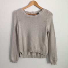 """✨SALE✨Silver H&M Knit Sweater with Back Zipper Cute for special occasions! Sparkly silver knit sweater from H&M. Zipper up the back, wear it unzipped for an off-the-shoulder look. Slightly hi-low hem. Size 4, laid flat measures 17"""" wide, 22"""" long. Great condition! H&M Sweaters Crew & Scoop Necks"""