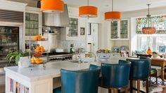 katierosenfeld-project-livingcolor-kitchen orange island lights, wood floors, white kitchen aqua and orange curtains