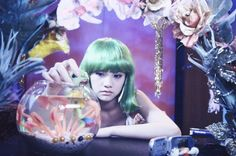 This girl in a green wig looks so cute!