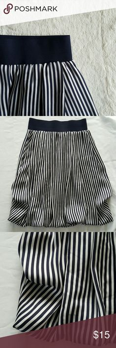 """H&M silky skirt Like new, no flaws. Navy blue color with silver stripes. I'm 5'9"""" and it's a knee lenght on me. H&M Skirts Midi"""